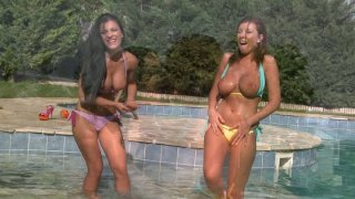 Astonishingly beautiful bitches stroke each other's bodies near the pool