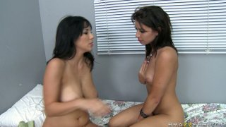 Two dirty dykes Ann Marie Rios and Jelena Jensen are scissoring on a bed