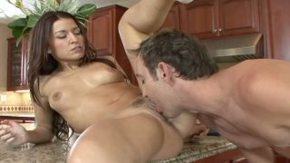 Flexible brunette Ann Marie Rios gets her pussy eaten and fucked in the kitchen