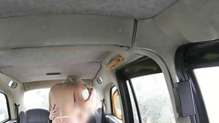 Hot blonde passenger analyzed by fake driver in the cab